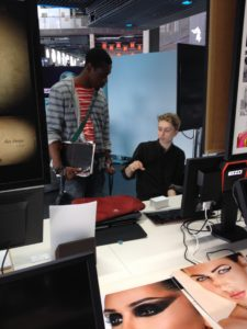Sam from Accumul8 chats with a motion graphics degree student from Ravembsourne