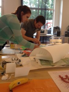 Nadia, from Ravensbourne College, and Kenny, from the NLYMCA hostel, collaborate on a drawing for the DECAY magazine