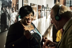 Olive Douglas, an Accumulate participant, shares her story with an Accumulate exhibition visitor